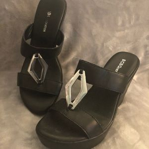 Black wedge slides with silver detail on straps